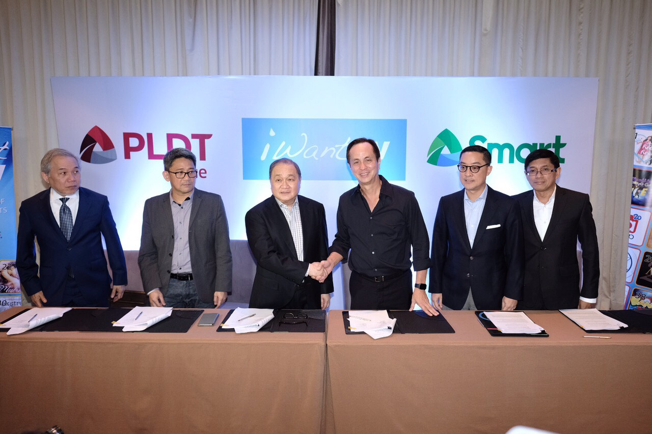 PLDT and Smart Chair Manny V. Pangilinan and Eugenio Gabby Lopez III lead signing of the milestone partnership of PLDT Home and Smart Communications with ABS-CBN for iWant TV. Joining them are Ariel P. Fermin, EVP and Head of Consumer Business for PLDT and Smart; Oscar 'Renren' Reyes, FVP and Head of Home Business for PLDT; Katrina Luna-Abelarde, FVP and Head of Smart Wireless Consumer Division; Gary Dujali, VP and Head of PLDT Home Marketing;  Kathy Carag, VP and Head of Smart and Sun Brand; Carlo Katigbak,  ABS-CBN President & CEO ; Aldrin Cerrado, ABS-CBN CFO; Rolando Valdueza, ABS-CBN Group CFO; Cat Lopez, ABS-CBN Head Finance for Broadcast; and Mellissa Limcaoco, ABS-CBN Head of Digital Transformation